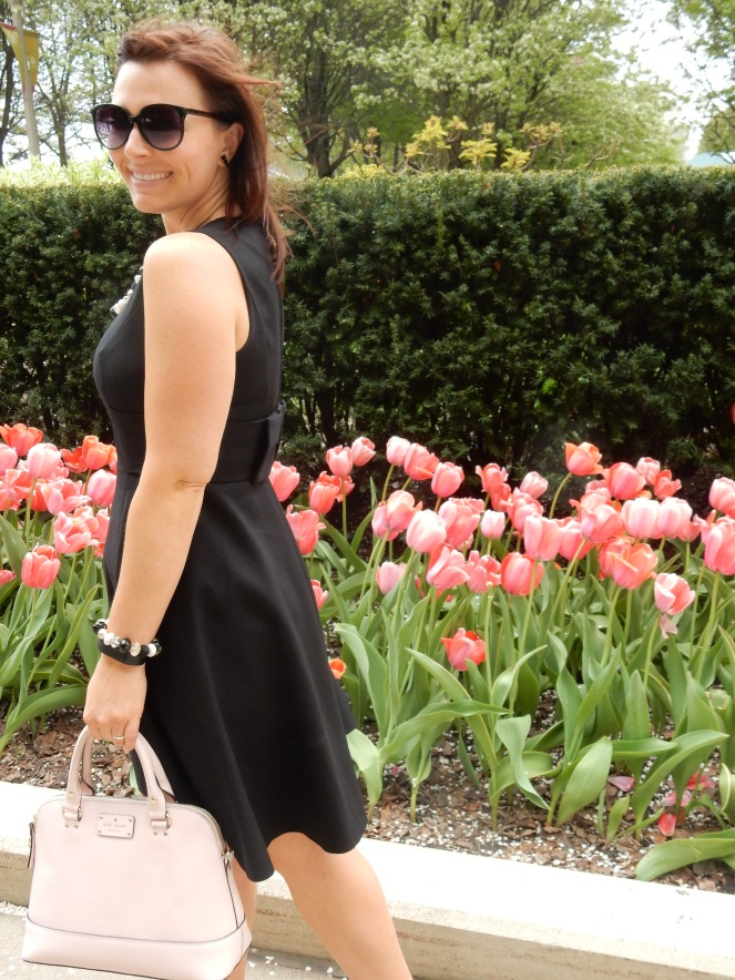 Chicago Millenium Park, Chicago Loop, The Bean, Cloudgate, Kate Spade, Chicago, downtown Chicago, chitown, sarah in style, little black dress, lbd, bow dress, bow earrings, pearls, sarah meyer, 100 years young, springtime, tulips, fresh, life