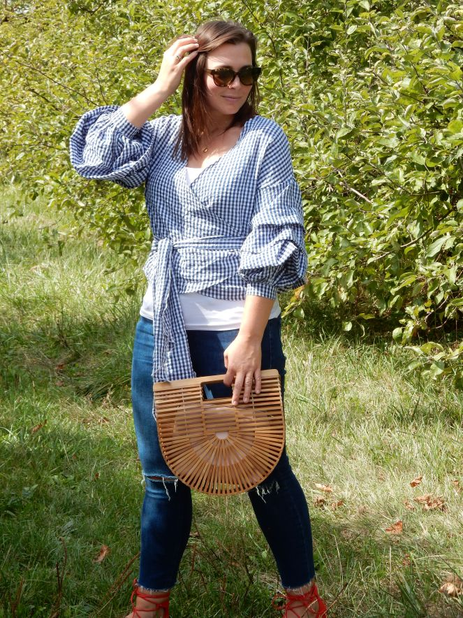 wood purse, fall fashion, seasonal clothing, what to wear this fall, fall trends, fall style, autumn style, apple orchard outfit, gingham ruffle top, gingham wrap top, red lace up flats, Pure Michigan, apple slushies, Sarah In Style, Sarah Meyer, fashion blogger, fashion blog, Chicago blogs, Chicago bloggers