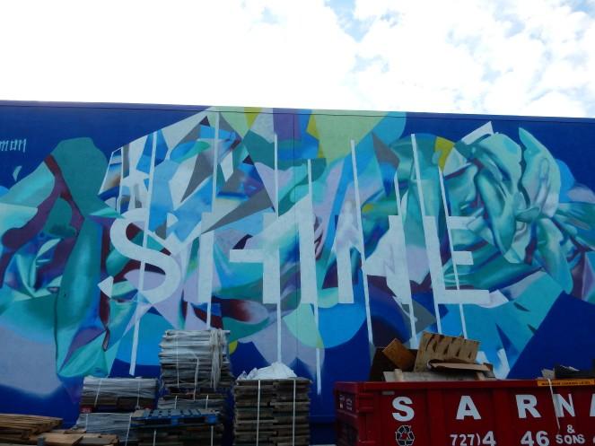 Tampa art, Tampa murals, Murals, Mural Art, St. Petersburg Murals, St. Pete Murals. St. Pete art, Florida art, street art. Sarah In Style, Sarah Meyer, St. Petersburg Florida, unique vacation ideas, vacation like a local, soft surroundings, pink sandals, lime green dress, tassel sandals