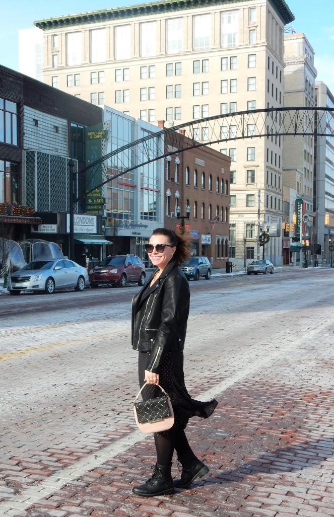 Sarah In Style, SarahInStyle.com, Sarah Meyer, Chicago Fashion Blogger, Michigan Fashion Blogger, Midwest Fashion Blogger, Flint Michigan, Downtown Flint, Flint MI, Michigan Cities, Leather Moto Jacket, Topshop Moto Jacket, J. Crew Black and Gold Polka Dot Dress, Pink and Black Studded Purse, Capitol Theater Flint, Kate Spade Sunglasses, Kate Spade Heart Ring, Gold Heart Ring, Tres Colori, Custom Rings, Year Ring, Chunky Gold Rings, Chunky Gold Necklace, Chunky Gold Jewelry, Shine Bright in Fashion, Shine Bright, Who What Wear, What to Wear, Outfit of the Day, 90's grunge fashion, 90's punk fashion, 90's fashion back in style