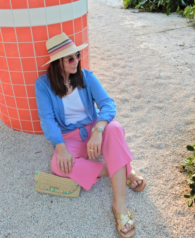 Sarah In Style, SarahInStyle, SarahInStyle.com, Sarah Meyer, Fashion Blog, Fashion Blogger, Chicago Fashion Blogger, Florida Fashion Blogger, Fashion Inspiration from blogs, What to wear in spring, Spring 2021 Fashion, Spring 2021 Fashion Trends, Styling bright pants, pink pants, colorful spring pants, colorful spring wardrobe, classic chambray button down, joules hat, pink sunglasses, lilly pulitzer sandals, gold criss cross sandals, chunky gold jewelry, fashion inspiration for spring, what to wear in Florida in spring, Whitney's Florida, Whitney's Longboat Key, retro fashion shoot, mid-century modern in Florida, Classic spring looks, Classic spring fashion, styling tips from bloggers