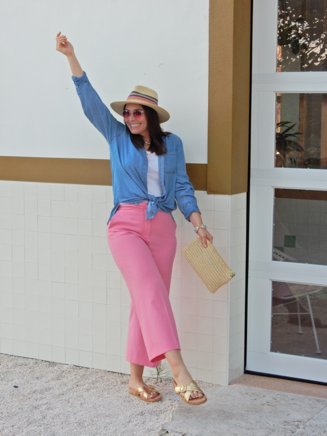 Sarah In Style, SarahInStyle, SarahInStyle.com, Sarah Meyer, Fashion Blog, Fashion Blogger, Chicago Fashion Blogger, Florida Fashion Blogger, Fashion Inspiration from blogs, What to wear in spring, Spring 2021 Fashion, Spring 2021 Fashion Trends, Styling bright pants, pink pants, colorful spring pants, colorful spring wardrobe, classic chambray button down, joules hat, pink sunglasses, lilly pulitzer sandals, gold criss cross sandals, chunky gold jewelry, fashion inspiration for spring, what to wear in Florida in spring, Whitney's Florida, Whitney's Longboat Key, retro fashion shoot, mid-century modern in Florida, Classic spring looks, Classic spring fashion, styling tips from bloggers, retro gas station, best restaurants in Sarasota, mid-century sarasota, what to do in Sarasota, Where to eat near Sarasota