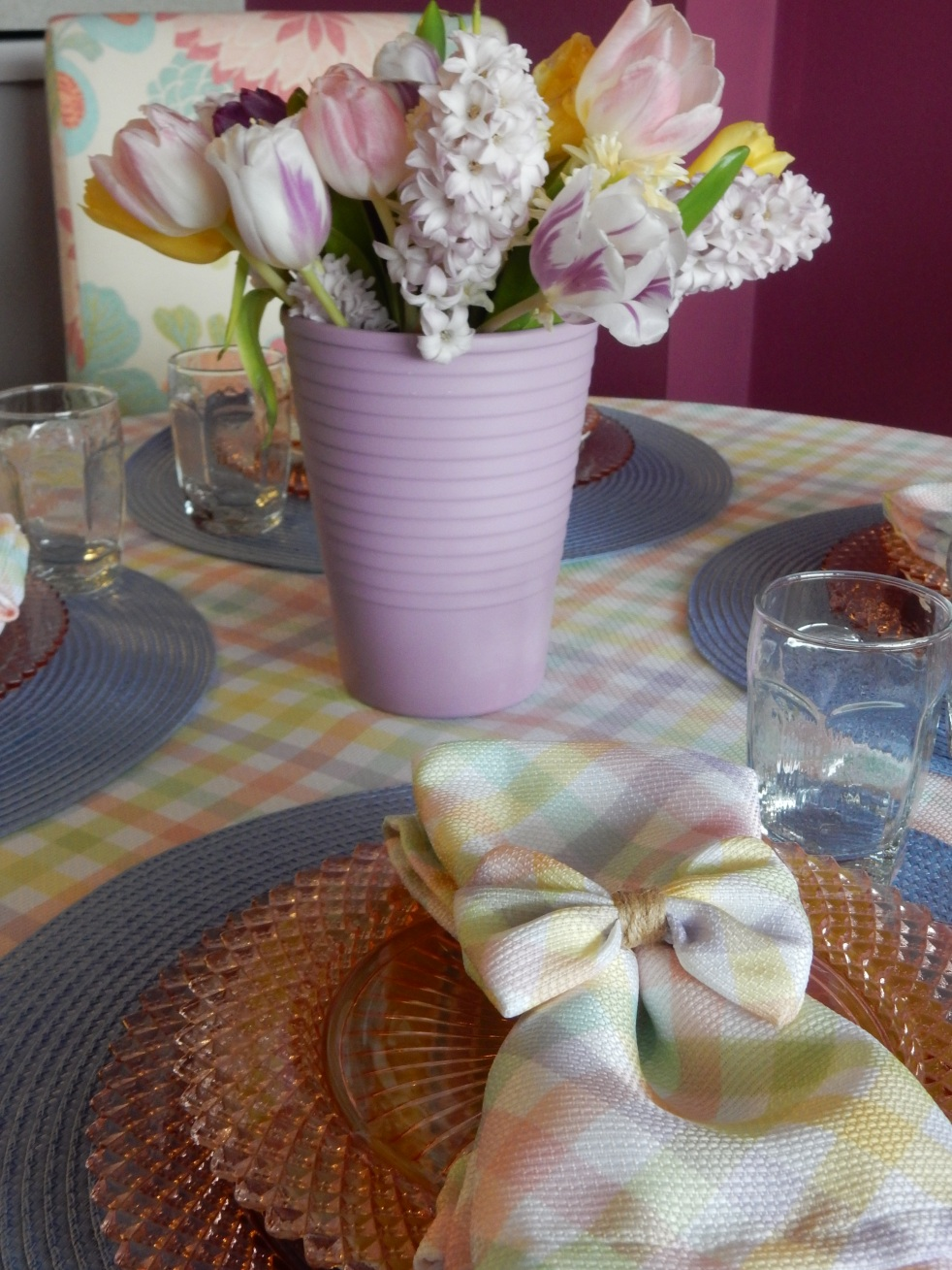 Sarah In Style, SarahInStyle.com, Sarah Meyer, Dining Decor, Hoppy Easter, Easter Table, Easter Decorating, Easter Decorations, Easter tablescapes, Spring tablescapes, spring tablescape, decorating for Easter, incorporating family traditions, where did the easter bunny originate, where is the easter bunny from, why do we hide easter eggs, cute table decor, miss america depressrion glass, pink miss america glass, plaid tablecloth, plaid napkins, bow napkin rings, table decorating ideas, wedding shower tables, baby shower tables, springtime decor. Easter 2021, Bed Bath and Beyond tableware