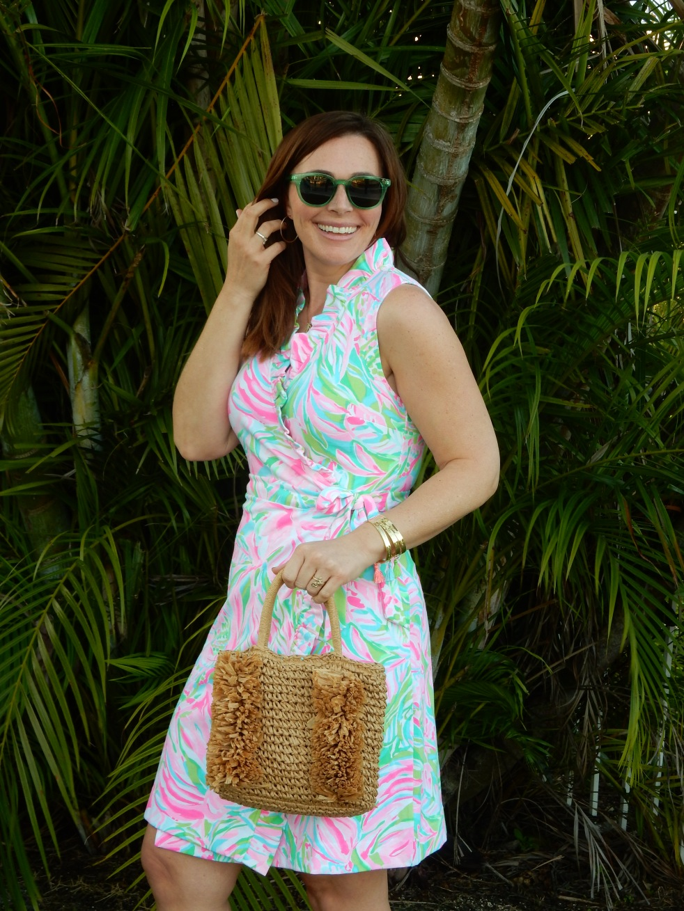 Wrapped in Summer, Lilly Wrap Dress, Lilly Pulitzer Wrap Dress, Mod Fashion, 1960's Fashion, 60s Fashion, Retro Fashion Inspiration, Lilly Pulitzer Print, Lilly Pulitzer History, Green Sunglasses, Lilly Pulitzer Bracelets, Fringe Straw Purse, Fringe Straw Bag, Mod Sandals, Block Sandals, Florida Fashion, Summer Style, Summer 2021 Fashion, Classic Summer Style, Classic Summer Fashion, Blogger Fashion Tips, What to Wear This Summer, What She Wore, Sarah Meyer, SarahInStyle.com, Sarah In Style, Tropical Fashion, Perfect Summer Style, Florida Fashion Blogger, Chicago Fashion Blogger, Loft Purse Sunglass Warehouse, Mermaid Ring, Alex and Ani Ring